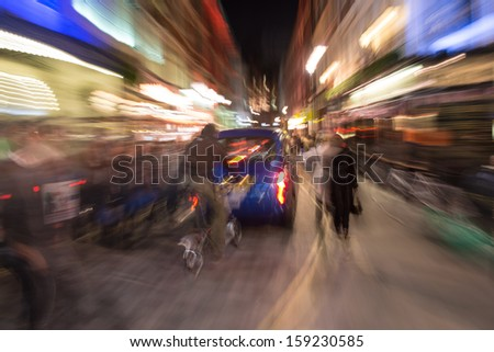 City traffic with motion blur at night in London - UK - stock photo