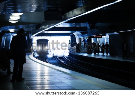 city underground metro with human silhouette - stock photo