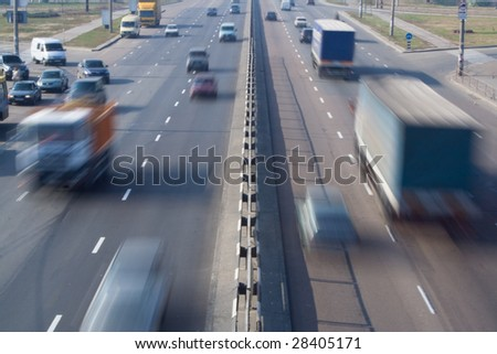 city urban scene heavy loaded highway street with blurred cars speed motion - stock photo