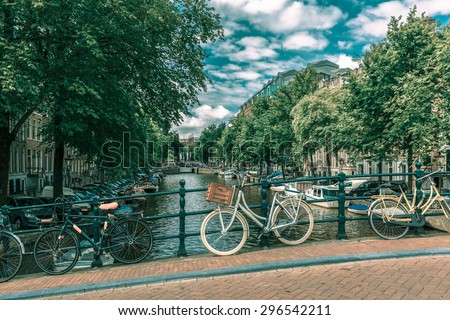 City view of Amsterdam canal and bridge, Holland, Netherlands.. Toning in cool tones - stock photo