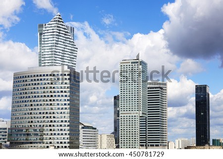 City view of Warsaw. InterContinental Hotel and Golden terraces. Few skyscrapers and blue sky.