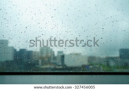 City view through a window on a rainy day - stock photo