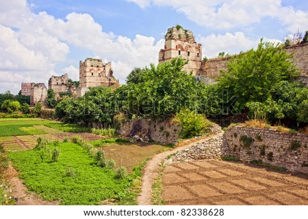 City Walls of Constantinople built by Byzantine Emperor Theodosius II and vegetable gardens on what once was the moat in Istanbul, Turkey - stock photo