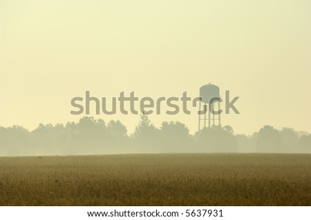 City water tower in morning golden light. - stock photo