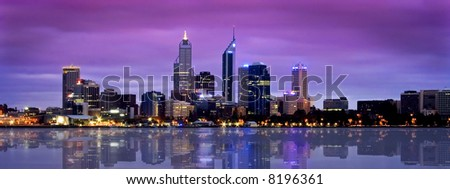 city with stunning river reflection - stock photo