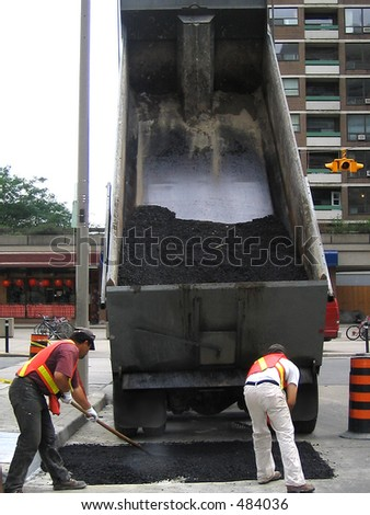 city worker paving ground