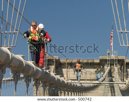 City workers on top of the Brooklyn Bridge - stock photo