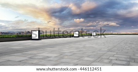 cityscape and skyline of hangzhou riverside new city in cloud sky on view from empty street - stock photo