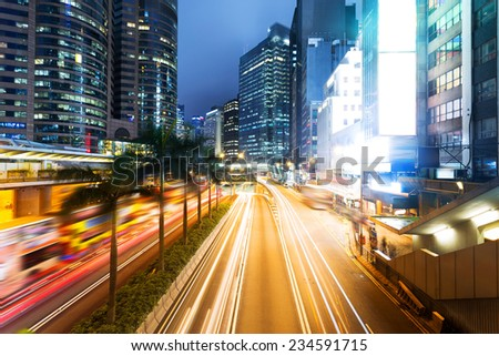 cityscape and traffic trails in hongkong. - stock photo