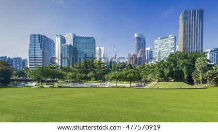 cityscape and trees grassland garden park at the business town in the morning