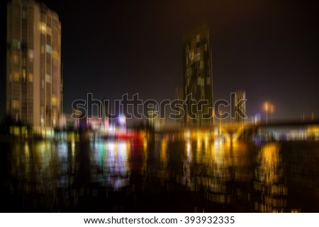 cityscape blurred image of the city bangkok at night