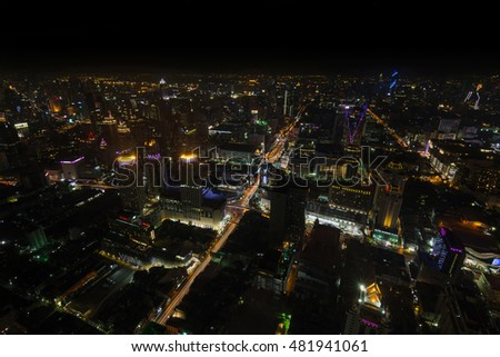 Cityscape, Expressway with light of car on road and Bangkok city with building and transportation in nighttime from Skyscraper by long exposure photography