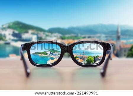 Cityscape focused in glasses lenses - stock photo
