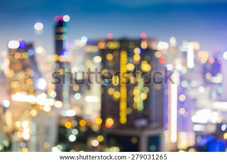 Cityscape night lights bokeh background - stock photo