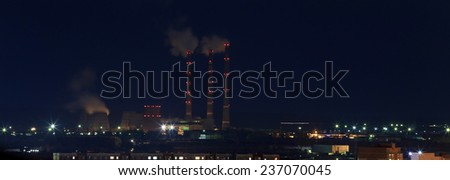cityscape night lights of the city to the horizon with a high-rise building - stock photo
