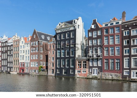Cityscape of Amsterdam city with historic houses along Canals
