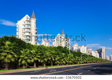 Cityscape of asian city viewed from a sidewalk of highway - stock photo