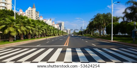 Cityscape of asian city viewed from zebra or pedestrian crossing - stock photo