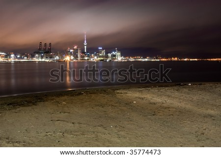 Cityscape of Auckland, New Zealand, across the water from Devonport. - stock photo