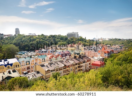 Cityscape of beautiful modern multicolor houses in green area - stock photo