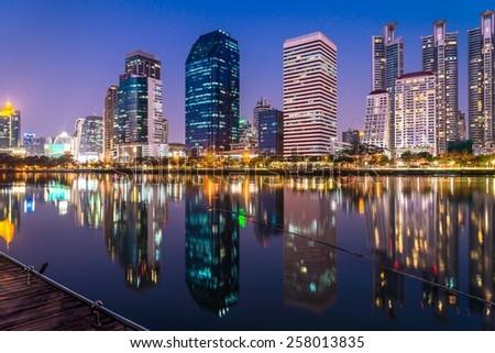 Cityscape of Benjakitti park Bangkok downtown city at night twilight evening, Bangkok Thailand - stock photo