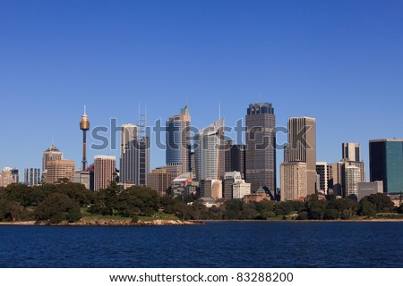 cityscape of big mega-polis sunny day weather blue sky harbour water and green botanic garden - stock photo