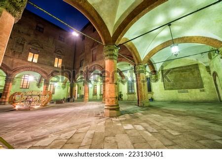 Cityscape of Bologna at night, Italy. - stock photo