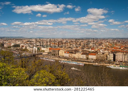 Cityscape of Budapest seen through greenery of the famous Gellert Hill. Beautiful travel background. - stock photo