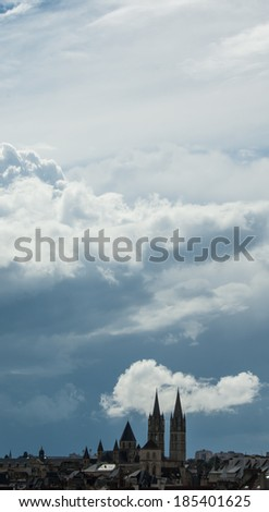 Cityscape of  Caen (Normandy, France) under dramatic sky.  - stock photo