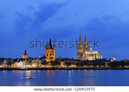Cityscape of Cologne with illuminated landmarks and cathedral, germany