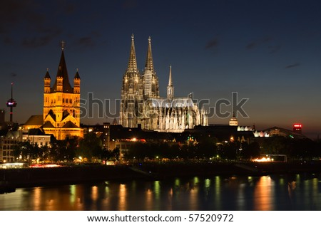 Cityscape of Cologne with the famous cathedral at dusk - stock photo