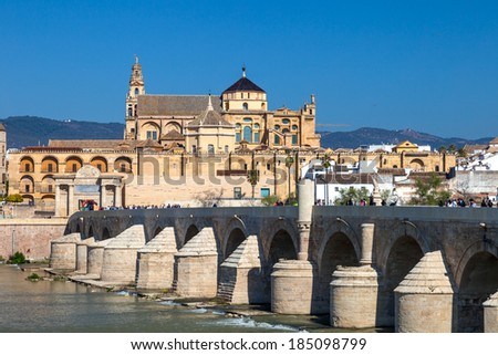 Cityscape of Cordoba with roman bridge and Mezquita, Andalusia, Spain - stock photo