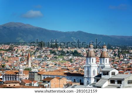 Cityscape of Cuenca, Ecuador with Santo Domingo church visible in the bottom right - stock photo