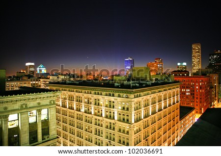 Cityscape of Downtown Los Angeles and Hollywood lights at night from rooftop - stock photo