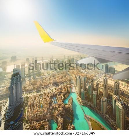 Cityscape of Dubai from aeroplane window, bird view, UAE - stock photo