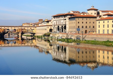 Cityscape of Florence, Italy with river Arno reflection. Uffizi Gallery and famous Ponte Vecchio bridge.