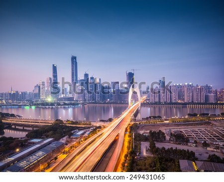 cityscape of guangzhou in nightfall, liede bridge across pearl river to the financial district - stock photo