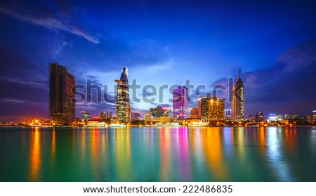 Cityscape of Ho Chi Minh city at beautiful sunset, viewed over Saigon river. Hochiminh is the largest city in Vietnam with population around 10 million people - stock photo