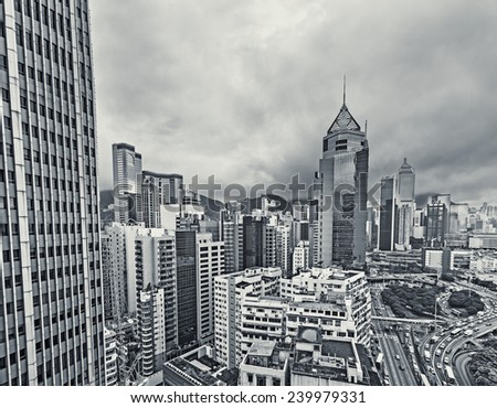 Cityscape of Hong Kong with high buildings in daytime, high angle view. - stock photo