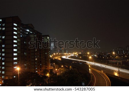 Cityscape of Kuala Lumpur from Berembang Flat during a rainy day.  Image has grain or blurry or noise and soft focus when view at full resolution. (Shallow DOF, slight motion blur)
