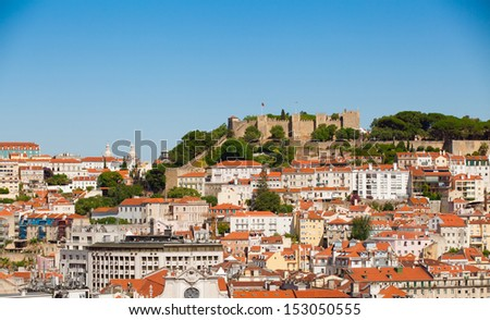 Cityscape of Lisbon, with Saint George Castle at the top of the mountain.