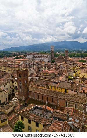 Cityscape of Lucca with cathedral and surrounding mountains, Tuscany, Italy - stock photo