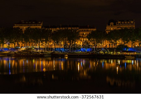 Cityscape of Lyon, France with reflections in the water at night