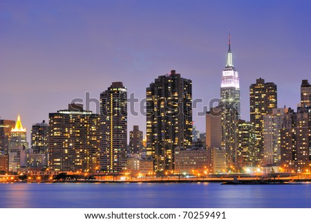 Cityscape of Midtown Manhattan across the Hudson River at night. - stock photo