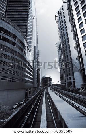 Cityscape of modern buildings and railway in city center. - stock photo