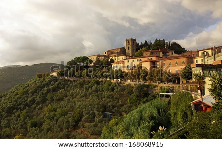 Cityscape of Montecatini, Italy.  The upper old city sits at the top of the mountain showing olive groves - stock photo