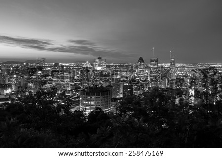 Cityscape of Montreal, view to the mountain of Mont-Royal in black and white at night - stock photo