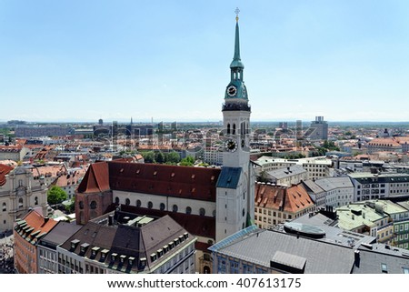 Cityscape of Munich, Bavaria, Germany seen from the top of city hall. St. Peter's Church, a Roman Catholic church, the oldest one in the district. - stock photo