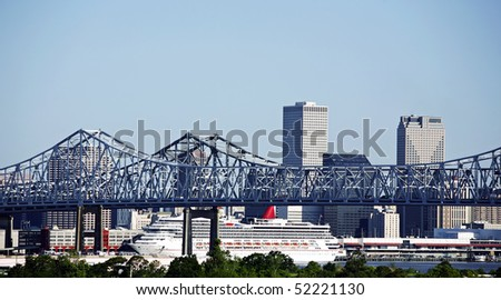 Cityscape of New Orleans, Louisiana, Mississippi bridge and cruise ship - stock photo