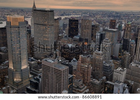 Cityscape of New York, USA, at dusk, showing the skycrapers with the numerous lights already on, seen from Top of the Rocks